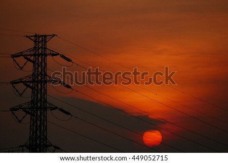 High voltage electricity pylon / power tower over Twilight with sunset  - stock photo