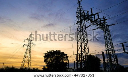 High voltage electricity pylons with sunset sky