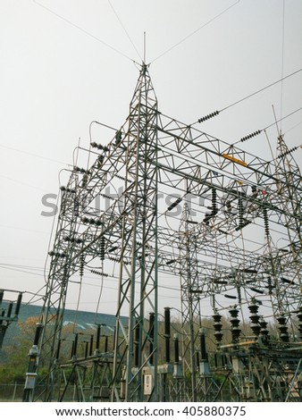 High voltage electricity transmission lines in Electrical Substation - stock photo