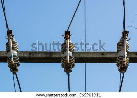 High Voltage Fuses onHigh voltage pole - stock photo