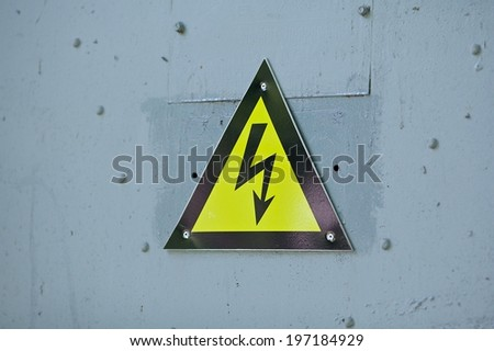High voltage hazard, high voltage danger sign, electrical symbol, black thunder and yellow triangle - stock photo