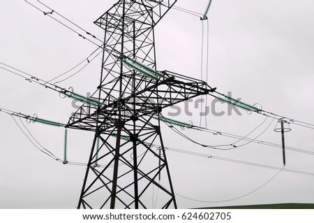 High-voltage line anchor support on a gray background