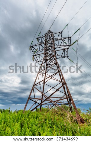 High voltage line on a background of cloudy sky - stock photo