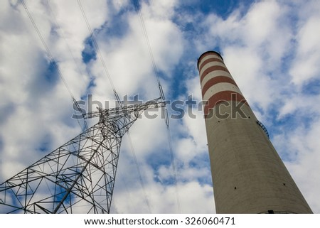 High voltage lines and chimney - coal power station. Europe. - stock photo