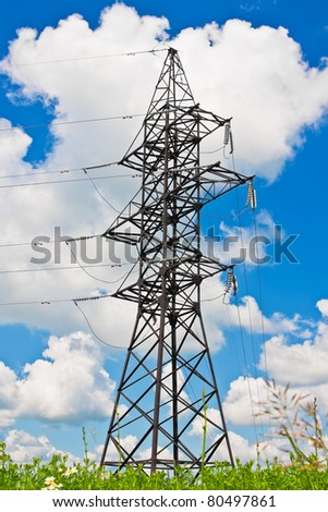High voltage lines on a background of the blue cloudy sky