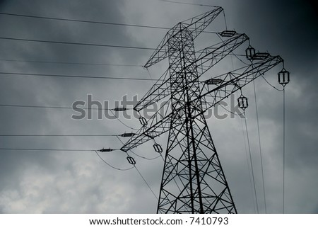 High voltage lines on stormy sky - stock photo