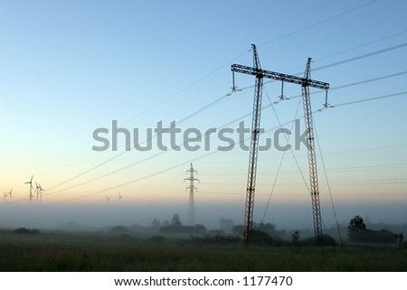 high voltage network in the early morning - stock photo