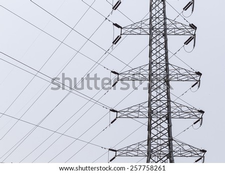 high voltage pole and line connected in nature background