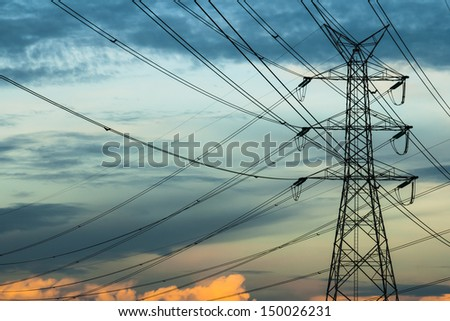 High voltage pole in sky background - stock photo