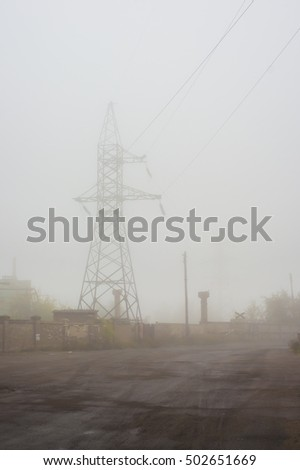 High-voltage pole in the mist