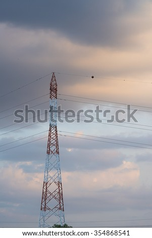 High voltage pole with sunset cloud