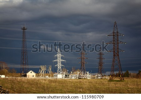 High-voltage poles with wires in the country - stock photo
