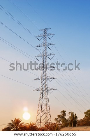 High voltage post at blue and orange sunset