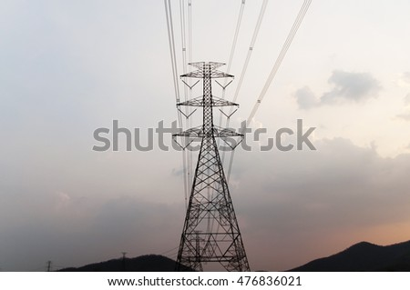 high voltage post at sunset, subject is blurred and low key