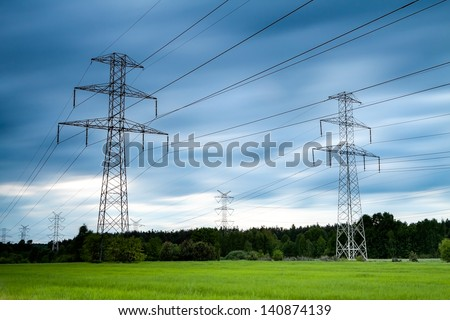 high voltage post. High-voltage tower sky background. - stock photo