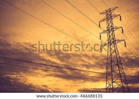 high voltage post.High-voltage tower sky background.Vintage color