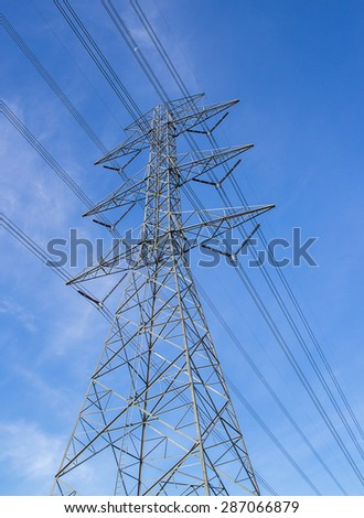 High voltage post. High voltage tower with blue sky background.