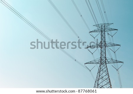 high voltage post with nice sky - stock photo