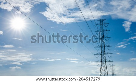 high voltage post with the sun - stock photo