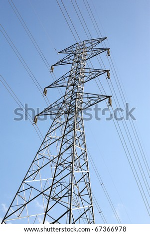 high voltage post with wire in blue sky