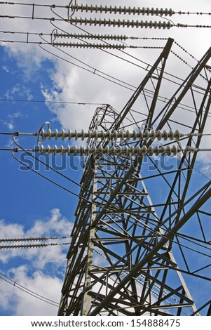 High voltage power cables supported by a pylon in the English countryside - stock photo