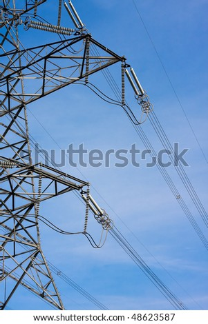High voltage power line at dusk - stock photo