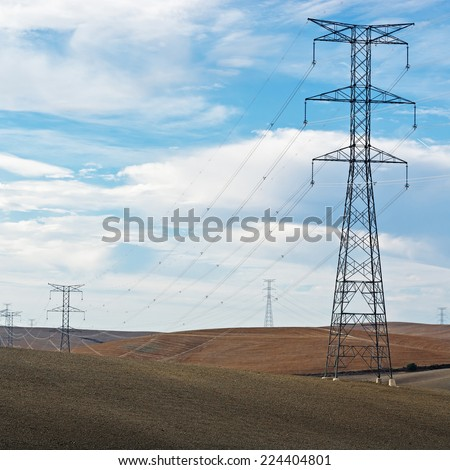 High-voltage Power Line on Plowed Sloping Hills in Spain