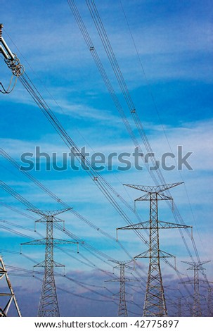 High voltage power lines at dusk - stock photo
