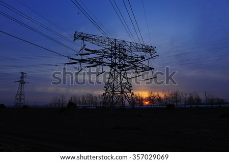 High voltage power lines at sunset
