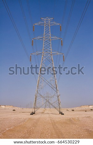 High voltage power lines in the desert. Zekreet, Qatar, Middle East.