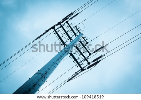 High voltage power lines under sky. - stock photo