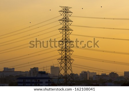 High voltage power pylons. - stock photo