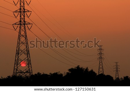 High voltage power pylons in sunset scene twilight