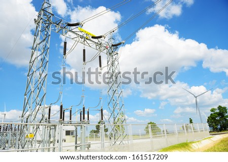 High voltage power transformer substation - storage power from wind turbines - stock photo