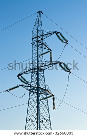 High voltage pylon with cables on blue sky background
