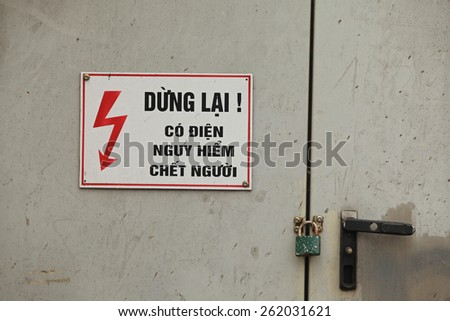 High voltage sign, danger warning in Vietnamese - stock photo