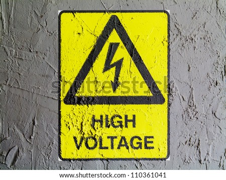 High voltage sign drawn at wall - stock photo