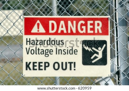 High Voltage sign on a fence - stock photo