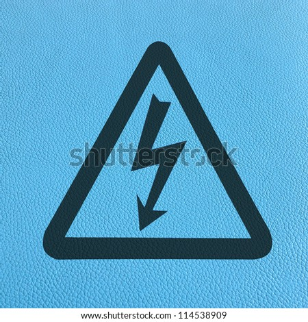 High Voltage Sign on blue leather, Symbol - stock photo