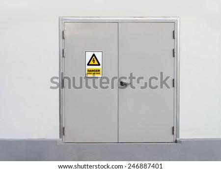 High voltage sign on metal door  - stock photo