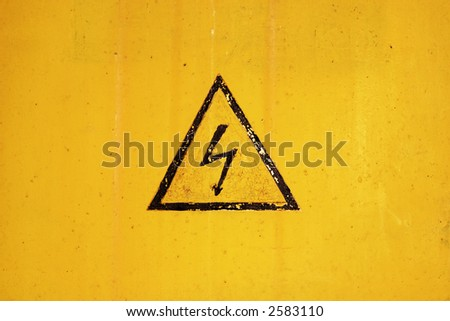 high voltage sign on ragged background - stock photo