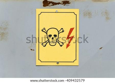 High voltage sign on rusty door - stock photo