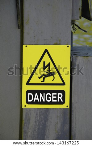 High voltage sign on the power line. Danger. - stock photo