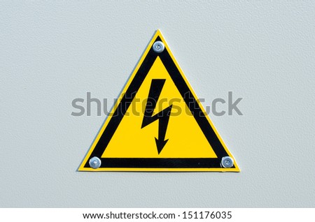 High voltage sign on white metal plate
