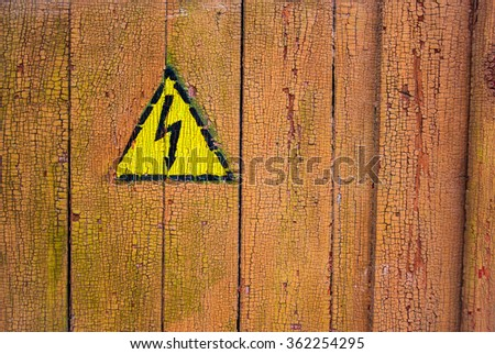 High voltage sing on old painted door - stock photo
