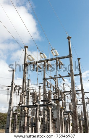 High Voltage Sub-Station against blue sky and clouds - stock photo