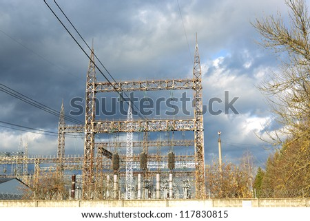 High Voltage  Substation against the background of a stormy sky - stock photo