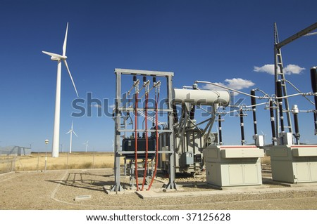 high-voltage substation and windmill - stock photo