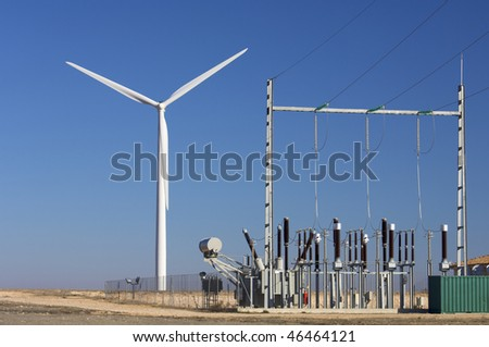 high-voltage substation and windmill with blue sky - stock photo