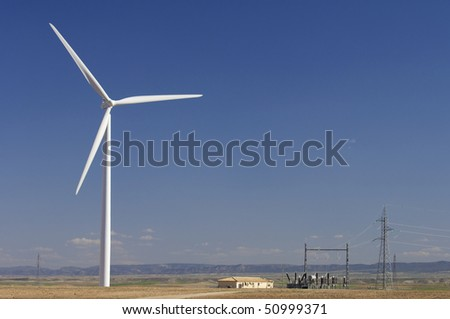 high voltage substation and windmill with blue sky - stock photo